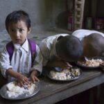Children. School children having mid-day meal in school, Radhu Khandu Village, Sikkim, India. Image credit: Keith Levit / 123rf. Illustration of global hunger article. Child healthcare concept.