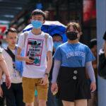 Mask-wearing in KUALA LUMPUR, MALAYSIA - FEBRUARY 22, 2020 : People wearing face mask to prevent infection of virus at Bukit Bintang. Bukit Bintang is a famous tourist attraction place. Image credit: Abdul Razak Latif / 123rf